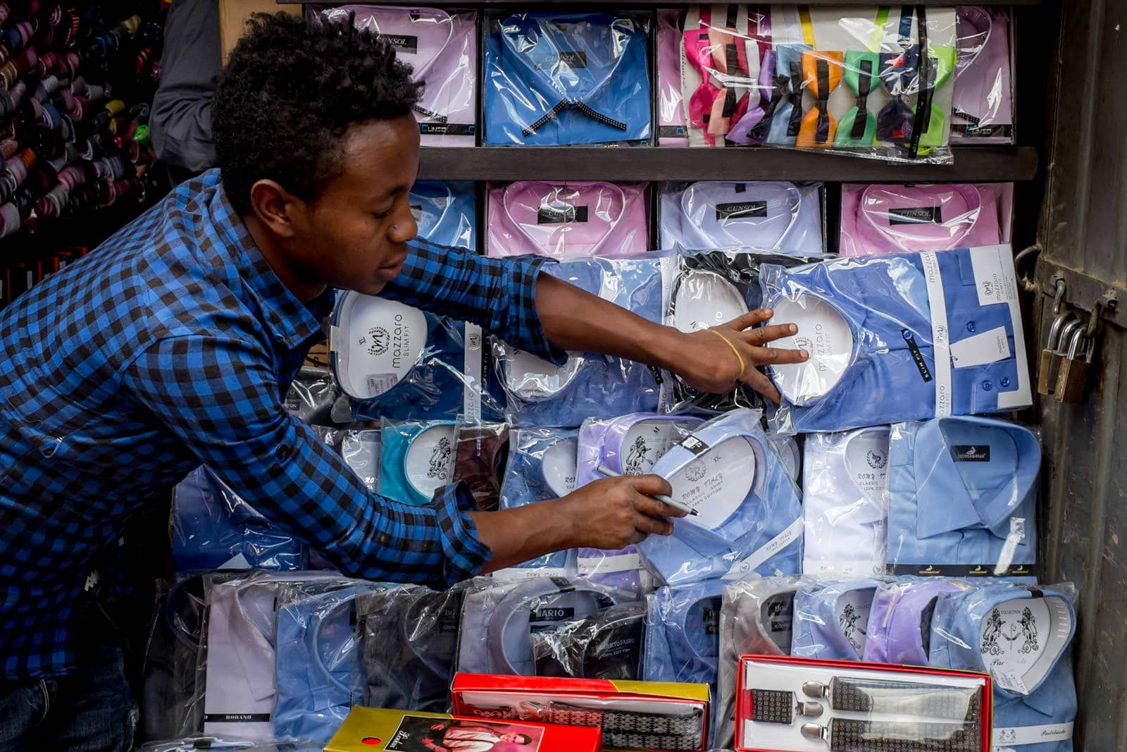 man selling shirts in Addis Merkato market in Ethiopia