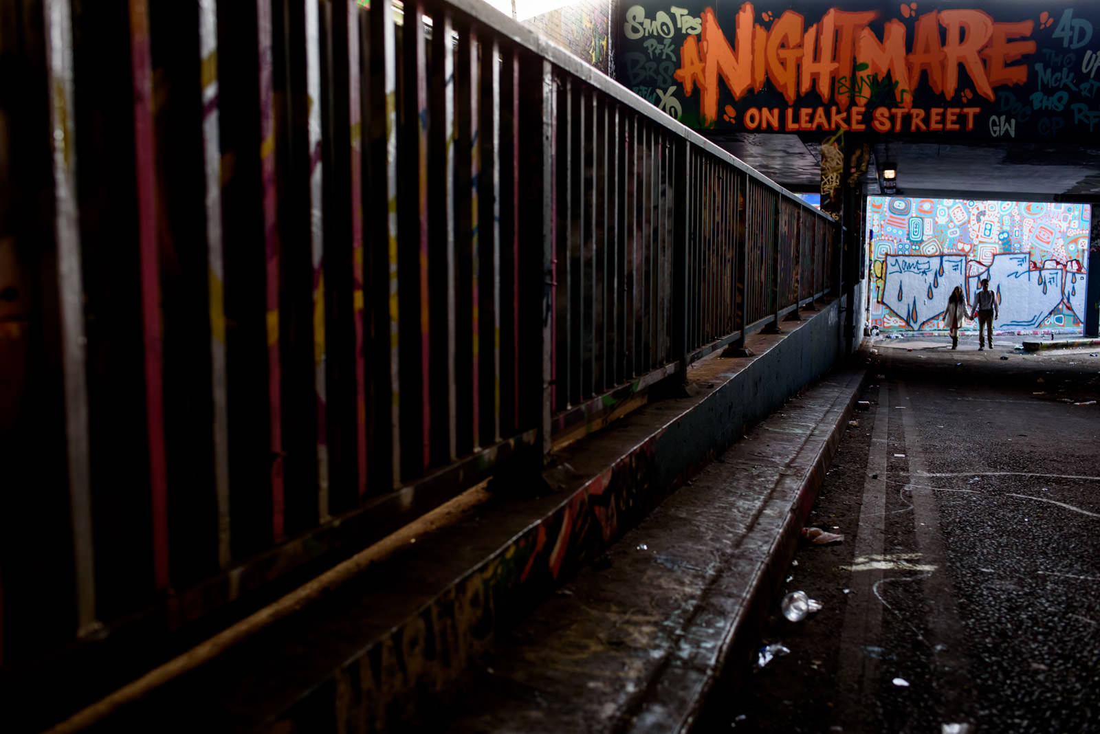 Couple engagement shoot in the Waterloo Tunnels with Nightmare on Leake Street Graffiti