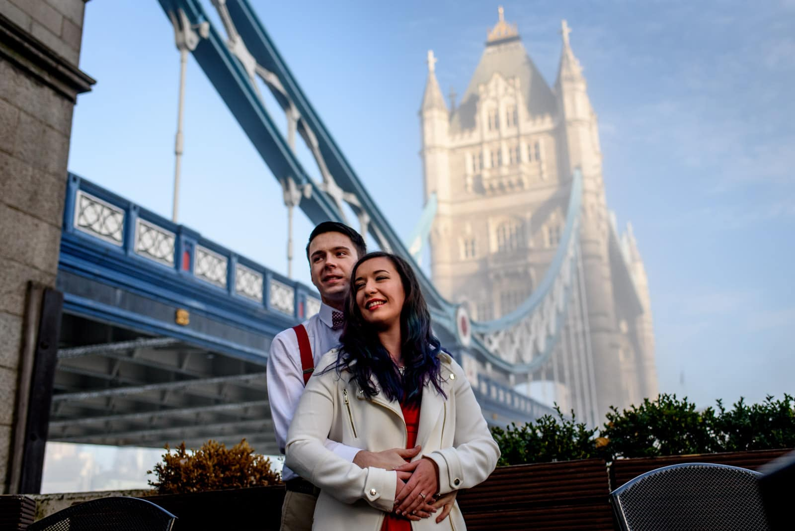 Boy and girl portrait shoot in front of Tower Bridge in London.