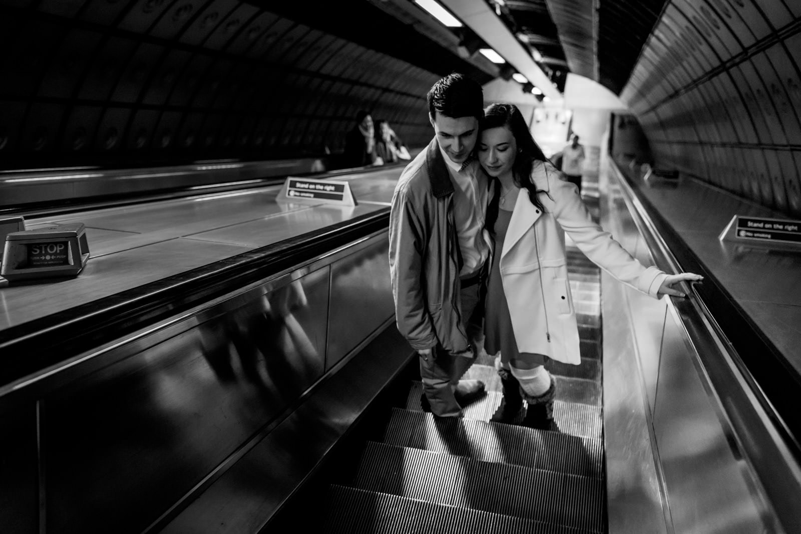 Couple on Underground escalators.