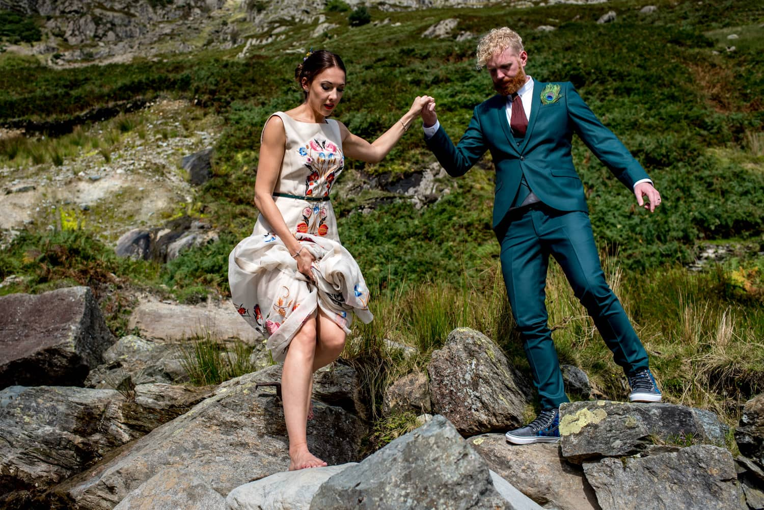 alternative Bride and Groom walking down a mountain in the Lake District