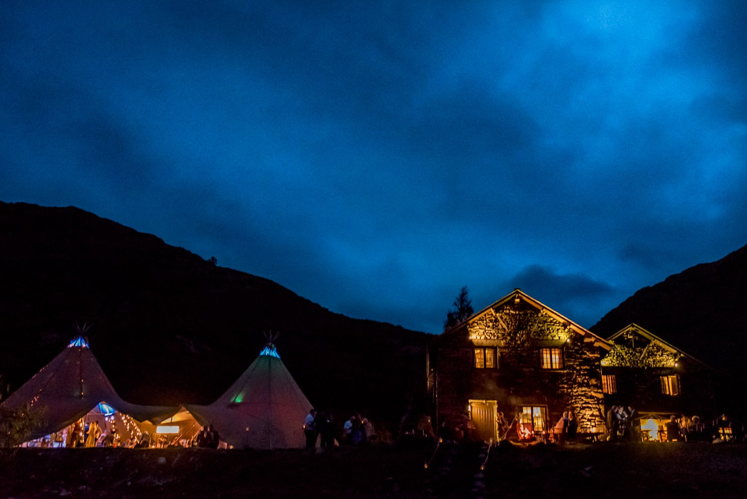 Coniston Coppermine Cottages at night for a wedding with a Tipi