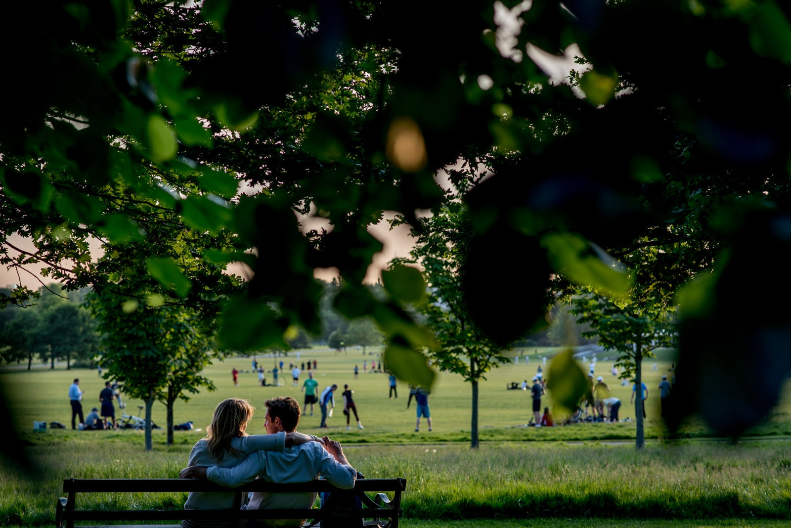 Couple sitting on a bench in regents park