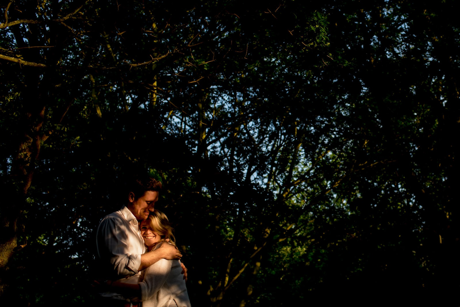 creative Regents Park engagement picture in beautiful light next to trees