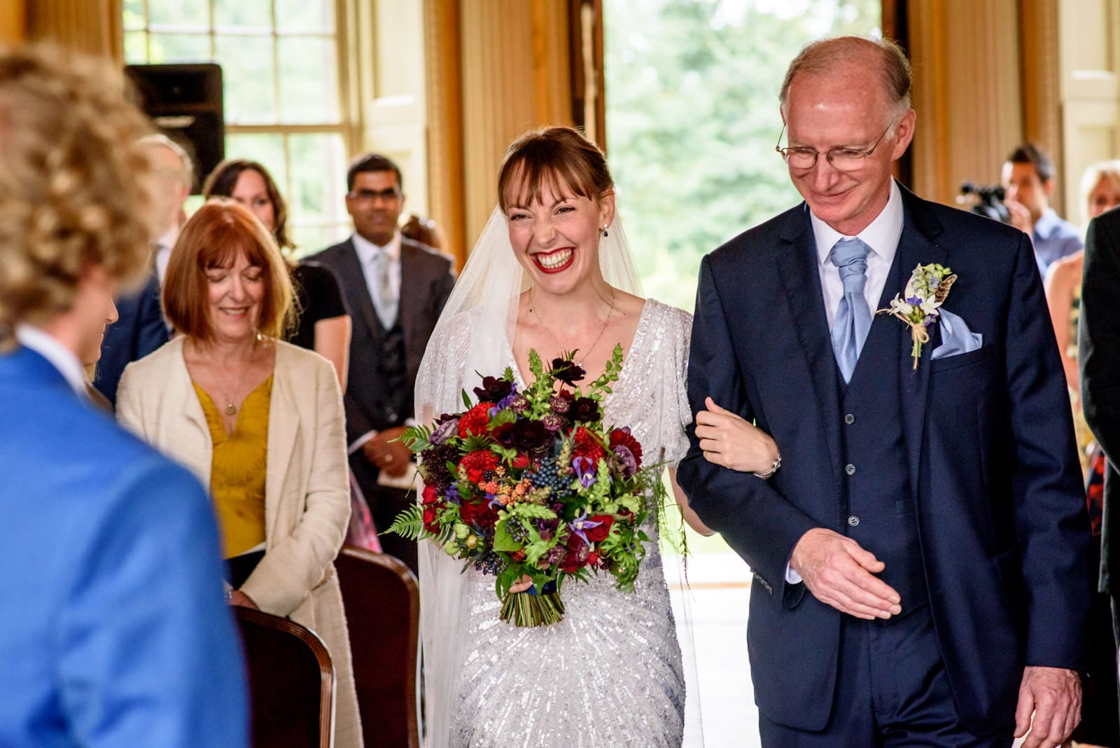 Bride walking down the aisle with her father at her Hampton Court Wedding