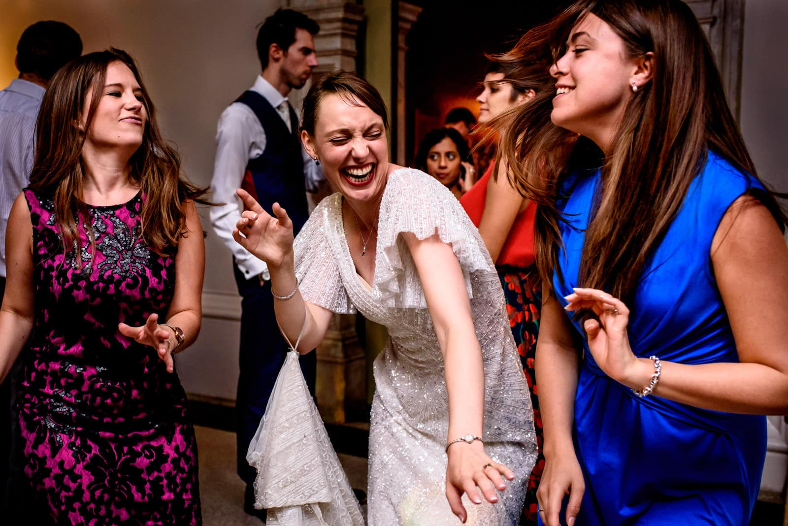 Bride dancing with bridesmaids at a Hampton Court House Wedding