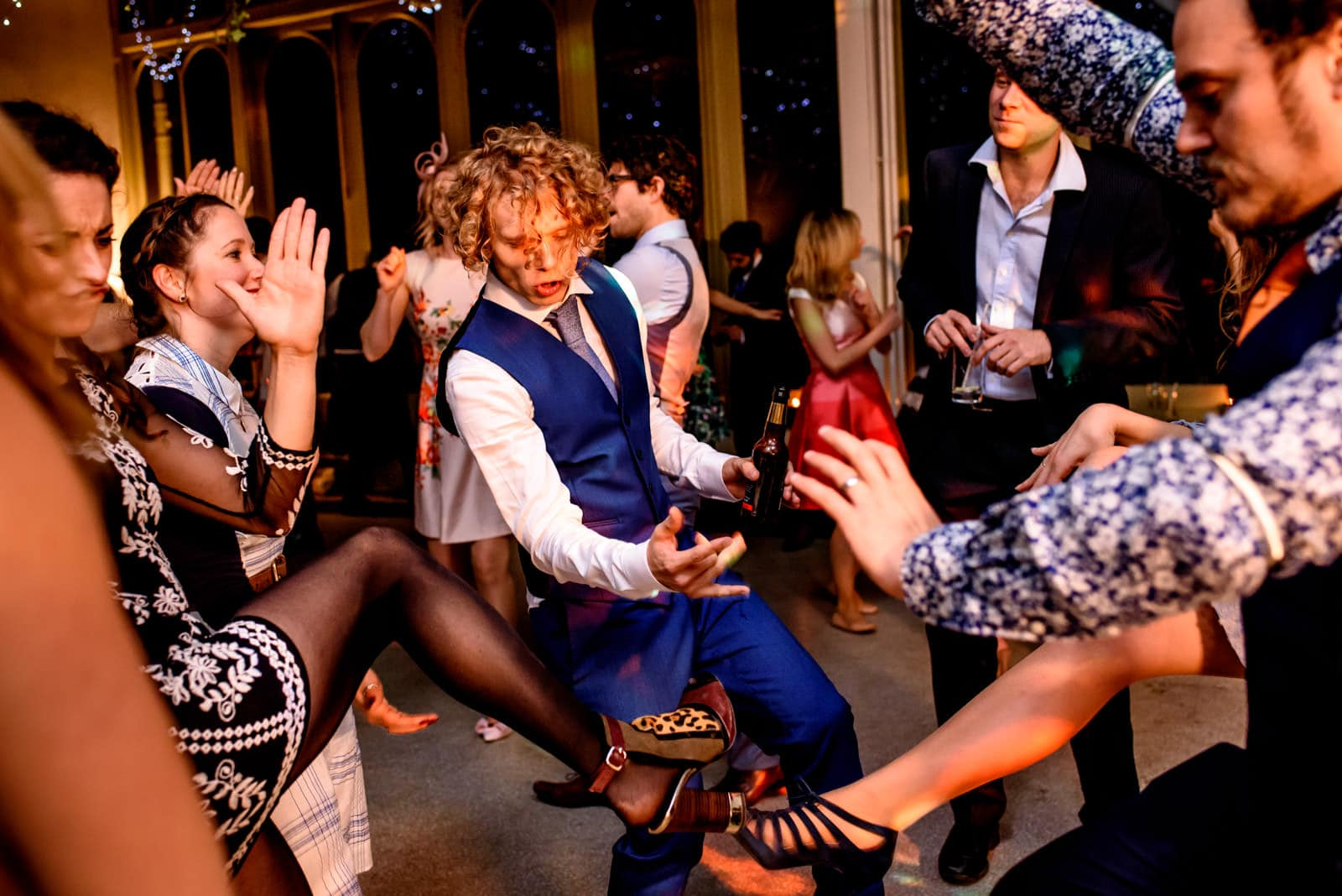 Groom dancing with guests at a Hampton Court House Wedding