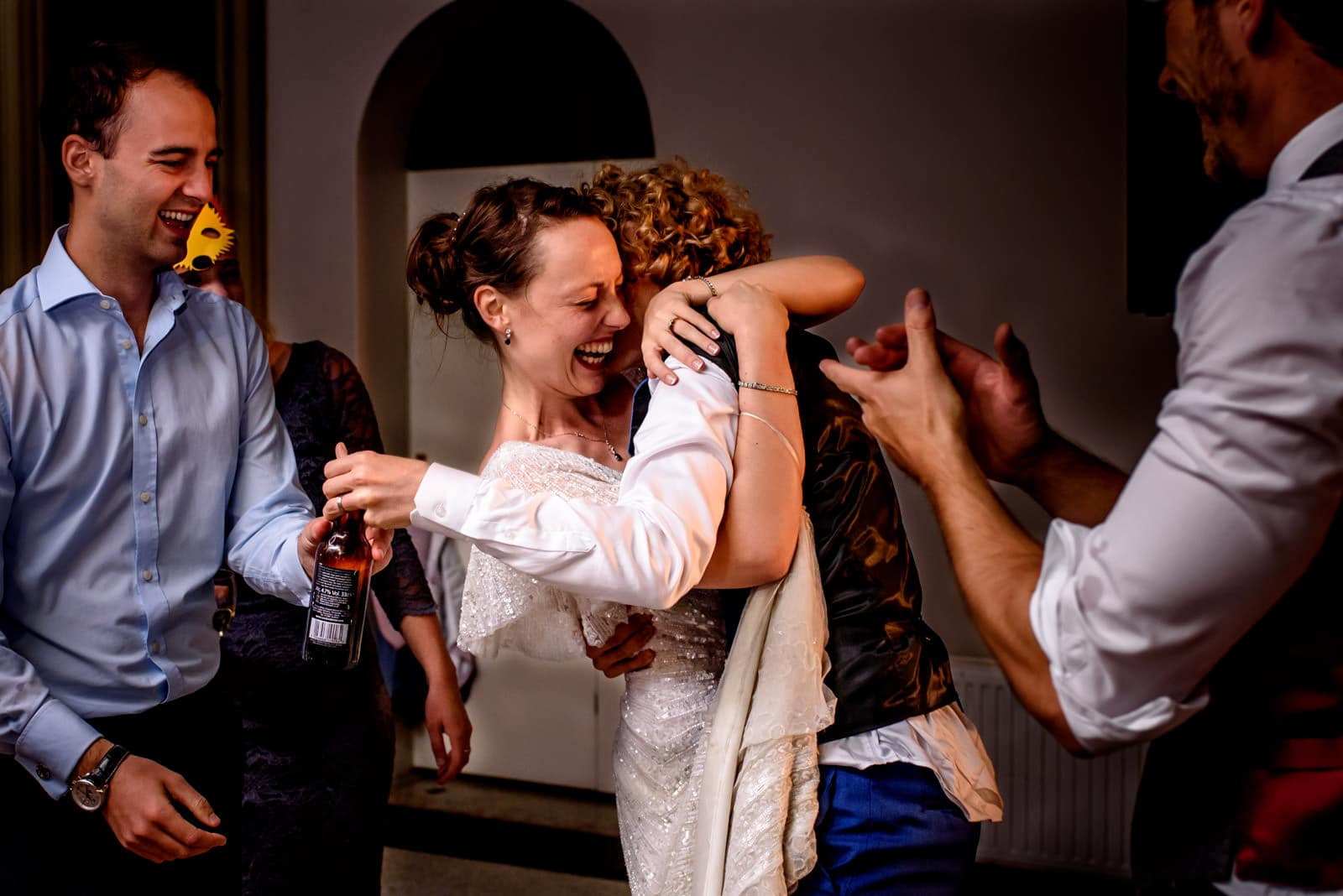 Bride embracing groom on the dance floor at Hampton Court House