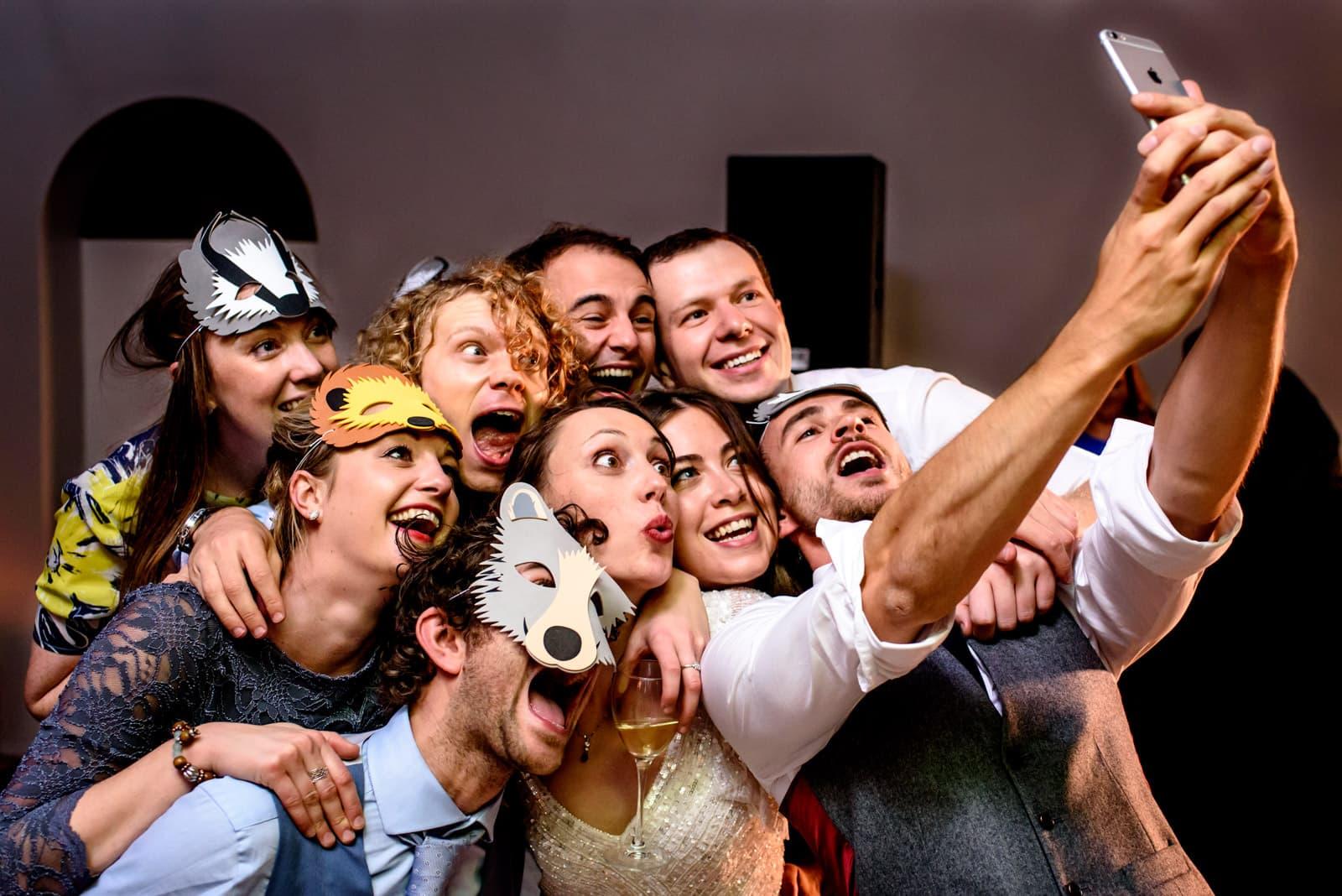 Group selfie on the wedding dance at Hampton court house