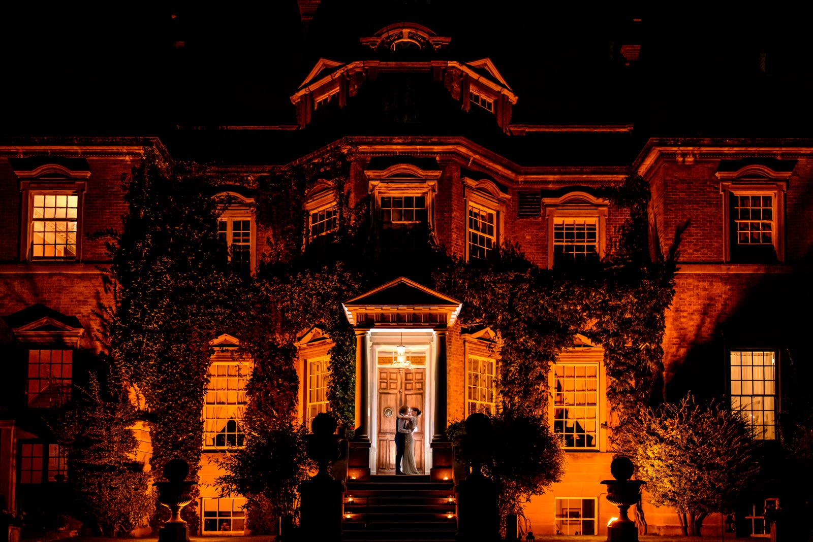 Hampton Court House lit up at night for wedding portraits