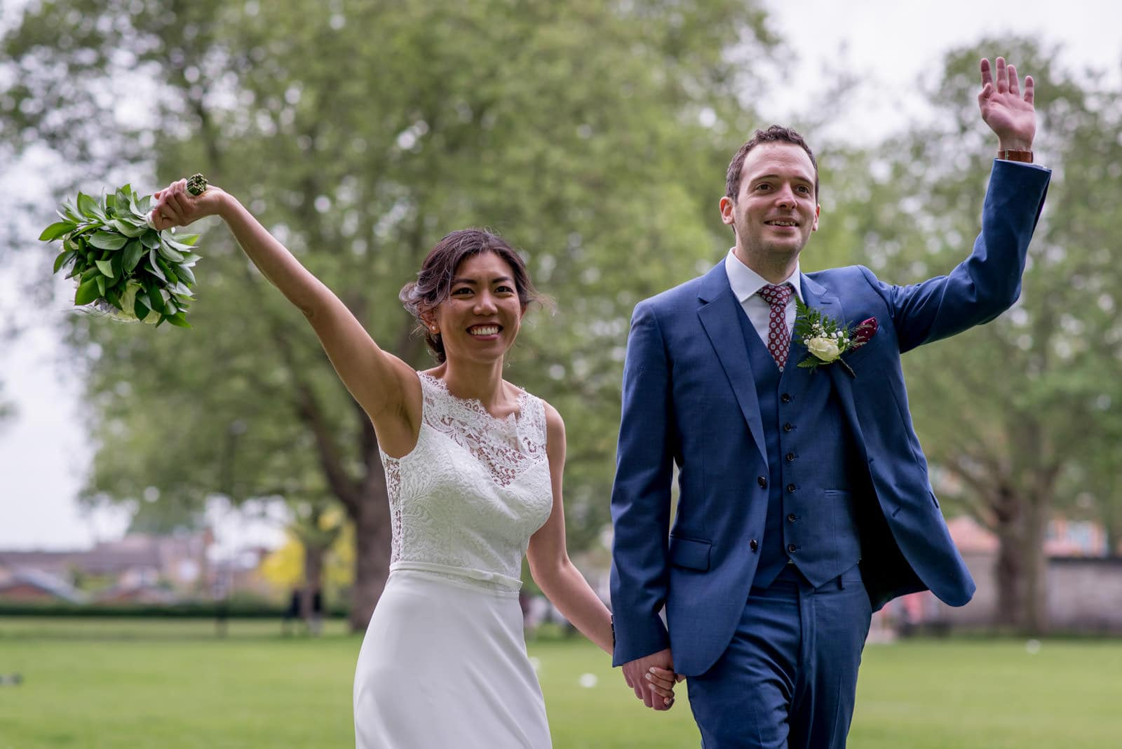Bride and groom waving at their wedding at the London Fields Brewery