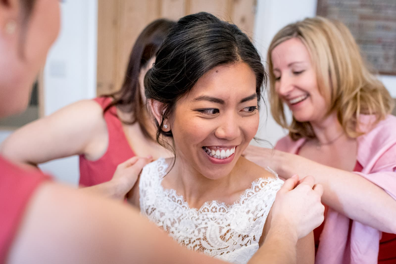 bride getting ready with her bridesmaides
