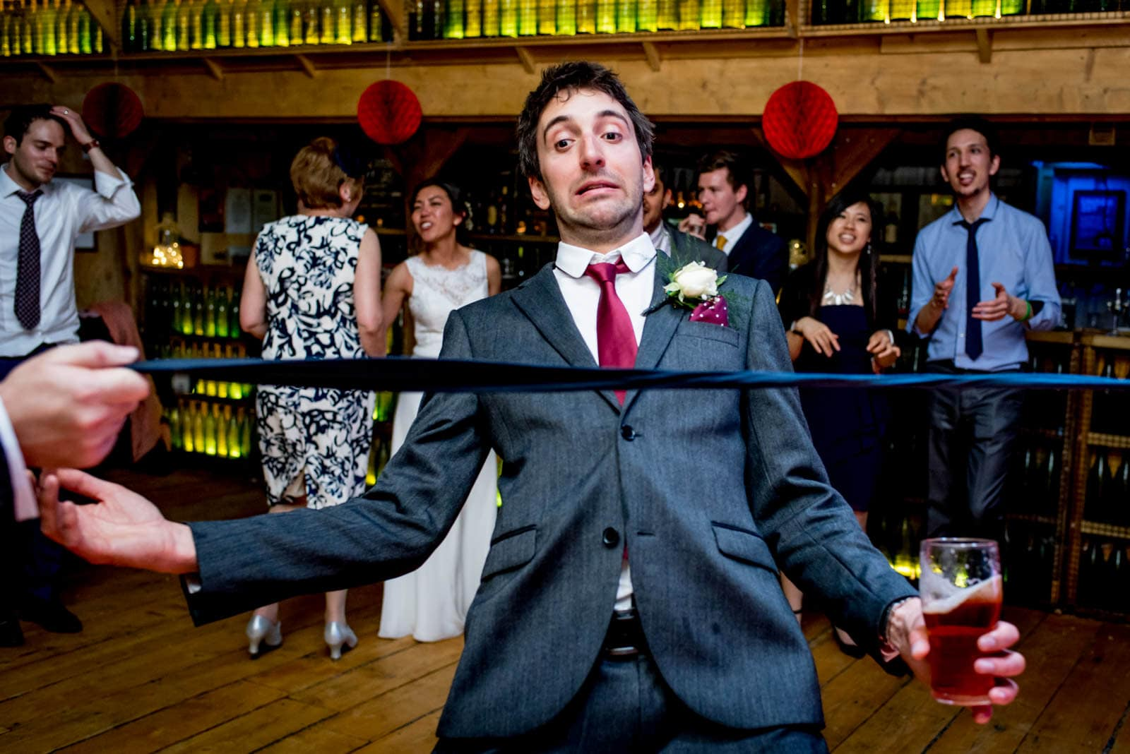 tie limbo on the dance floor at this wedding