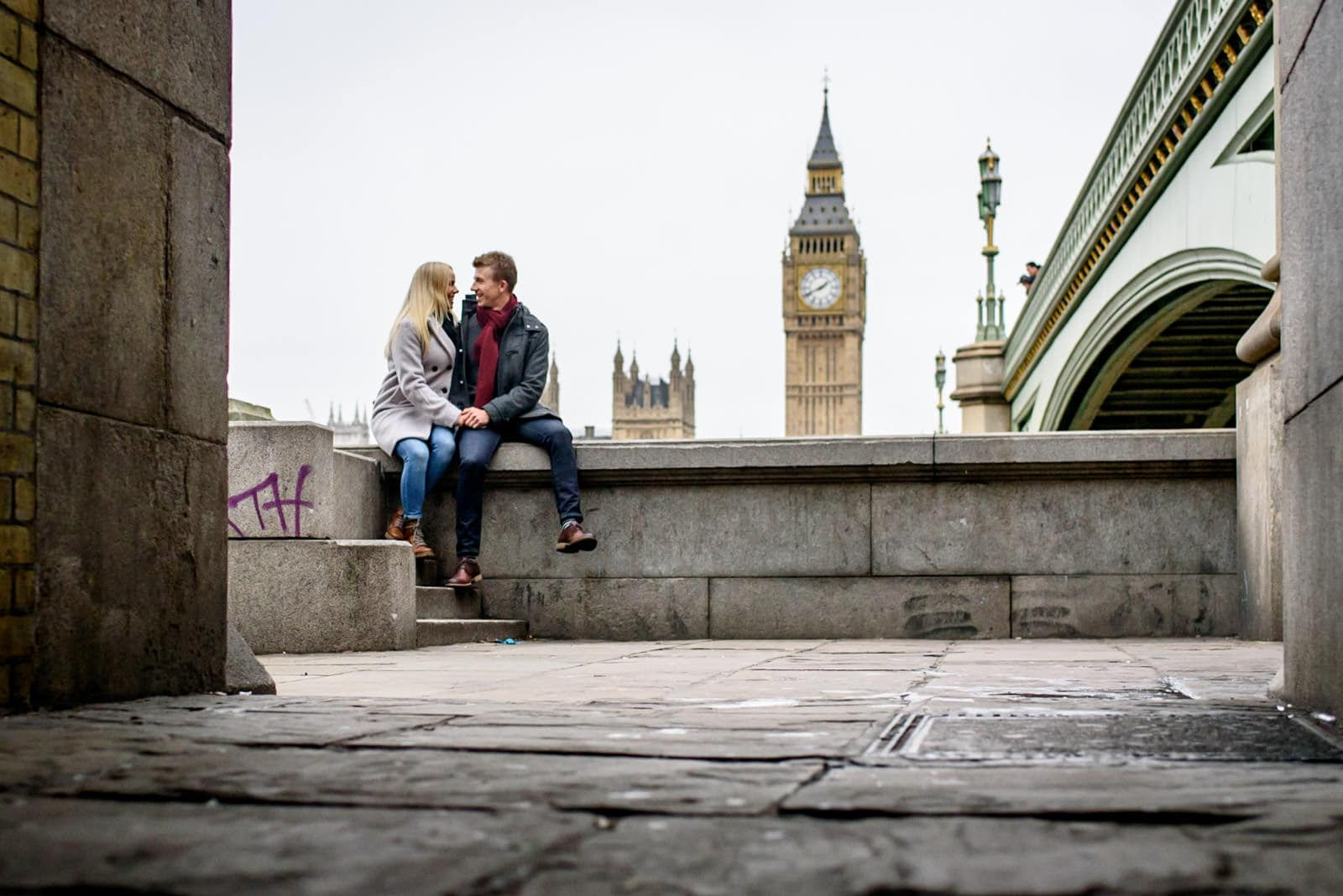 winter engagement photos with a couple by the Thames across from Big Ben