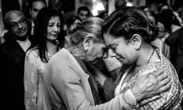 Black and white photo of Indian Bride hugging her Grandmother at her Moor Park Golf Club wedding.
