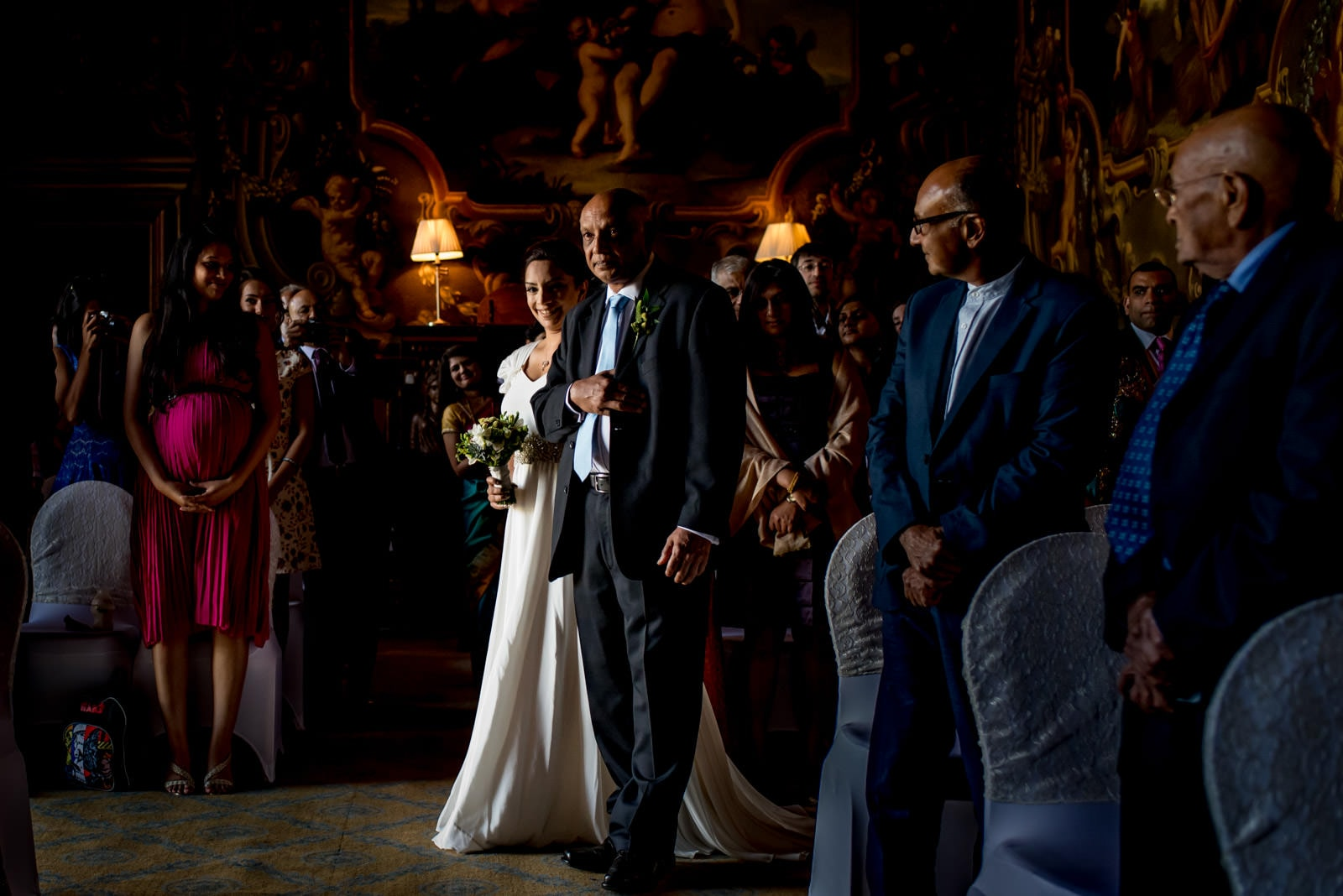 Indian bride walking down the aisle with her father at her wedding at Moor Park Golf Club
