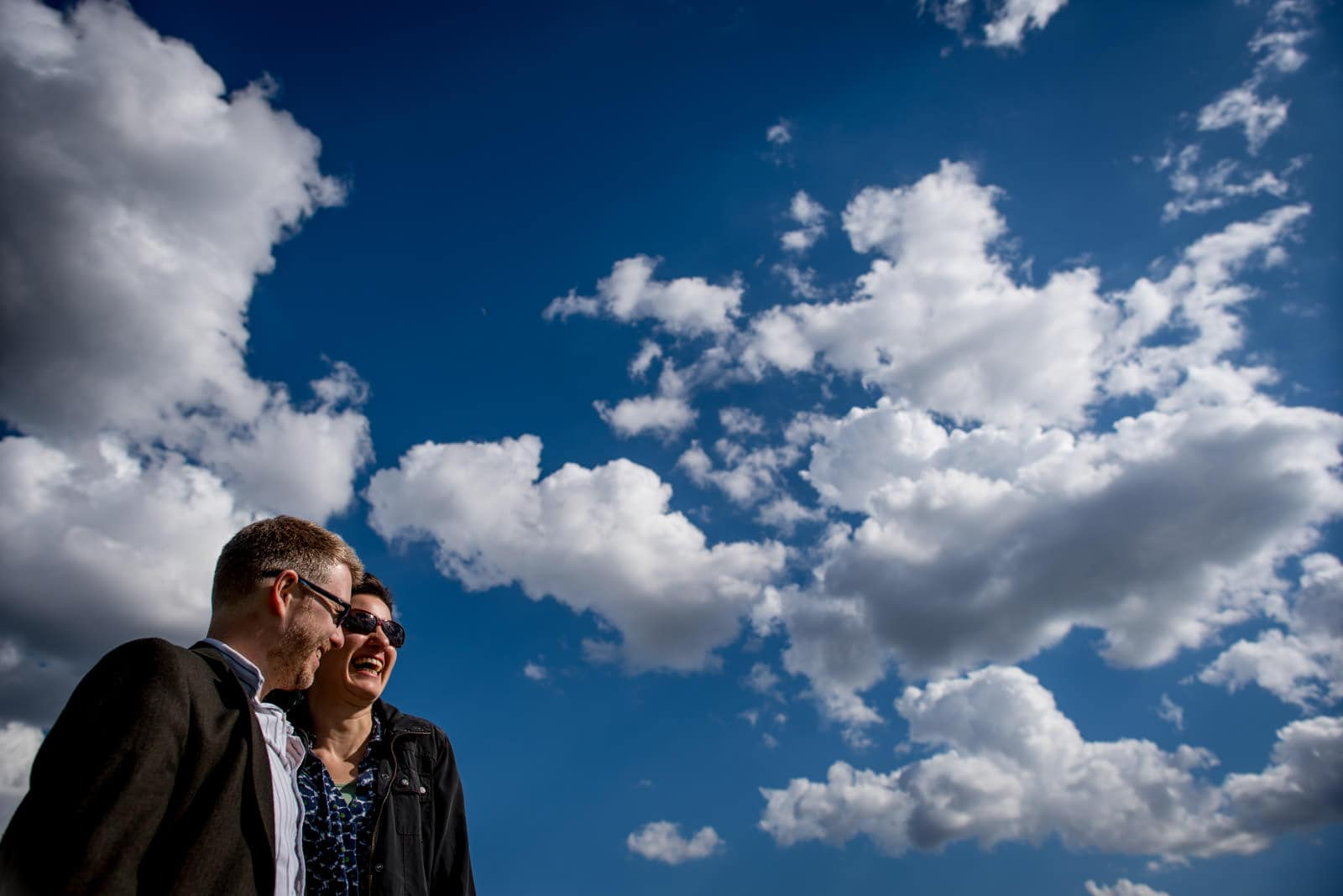 Smiling couple with blue sky and clouds