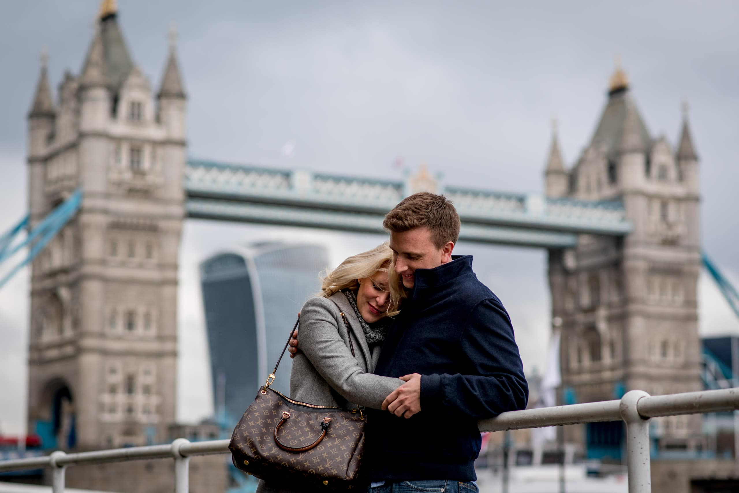 Couple in front of Tower Bridge during their Southbank Engagement Photo Shoot in central London.