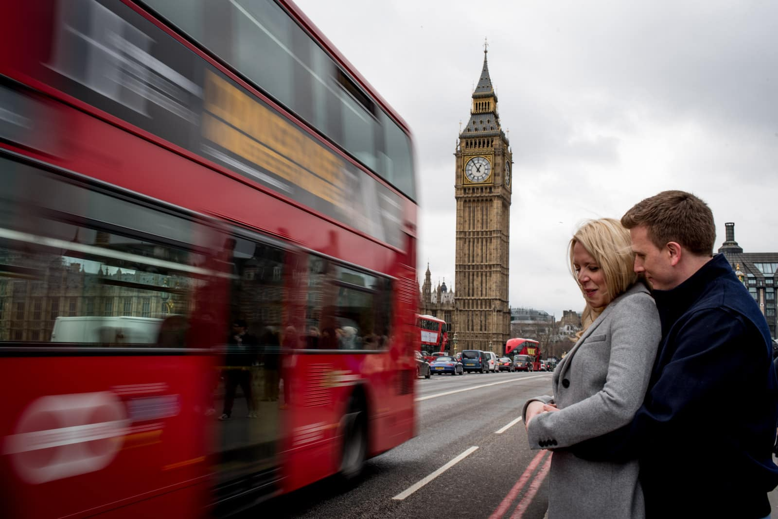 couple on Westminster Bridge with Red London Bus and Big Ben