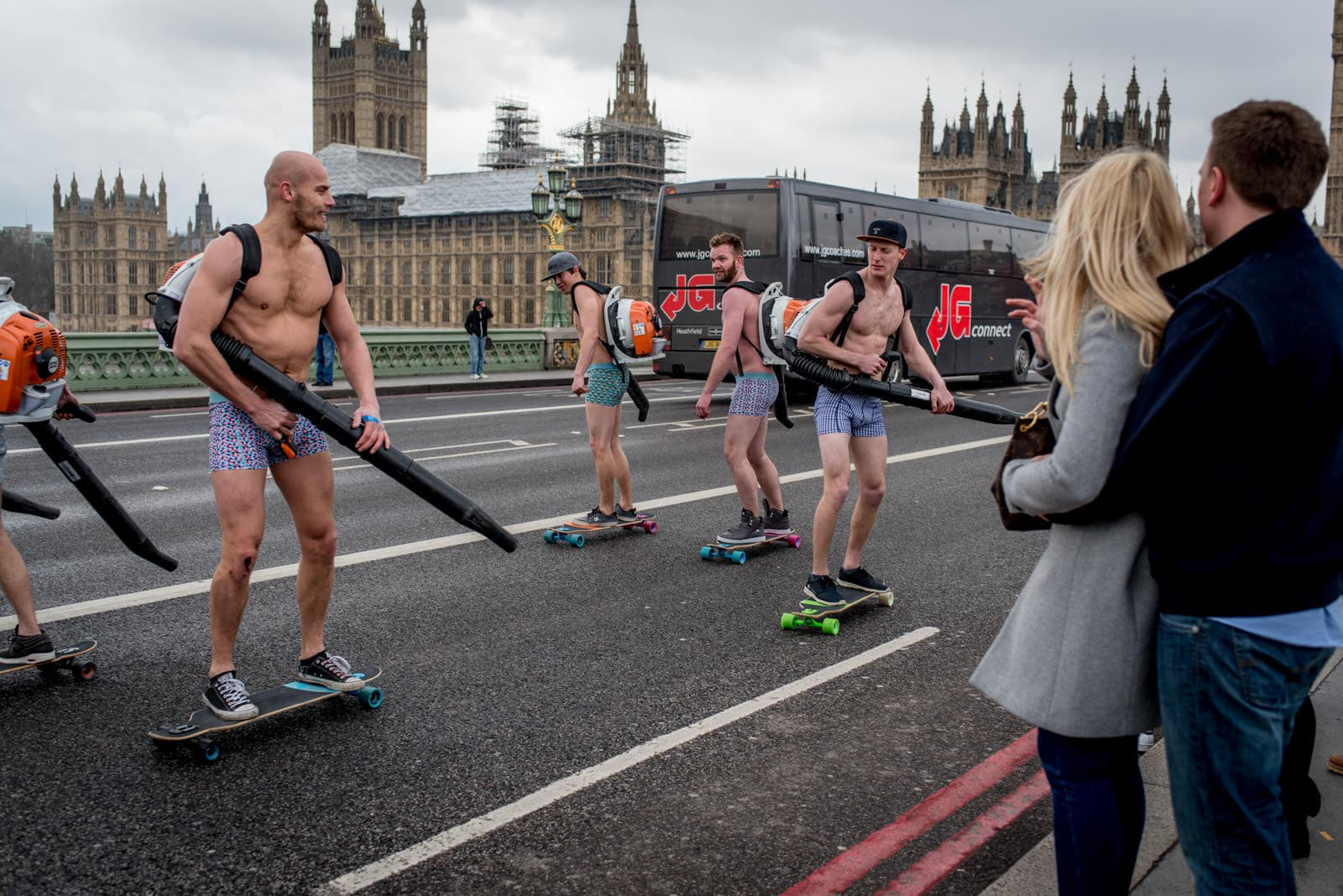 Naked skateboard leaf blower races on Westminster Bridge in central London