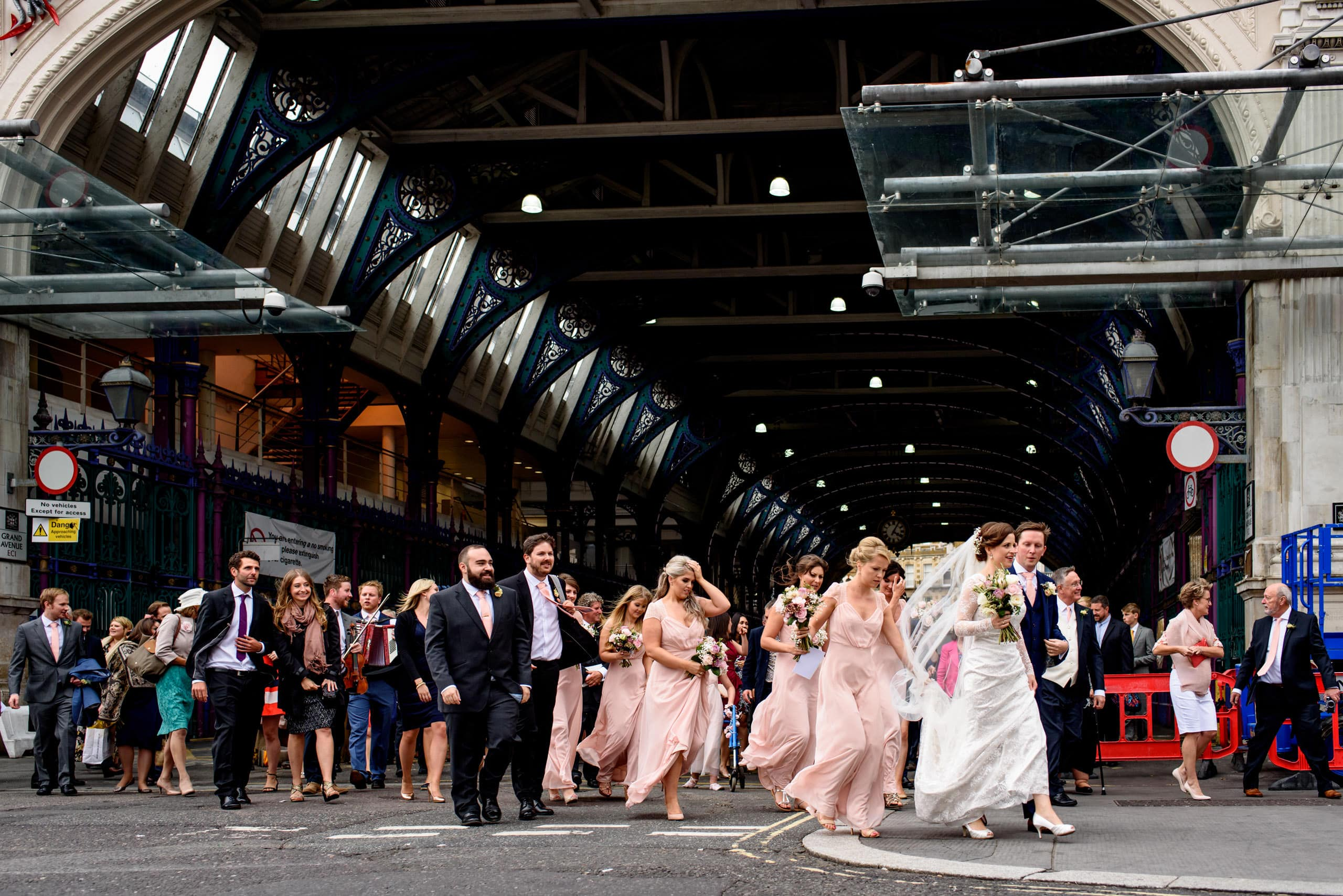 wedding party walking through Smithfields Market in London