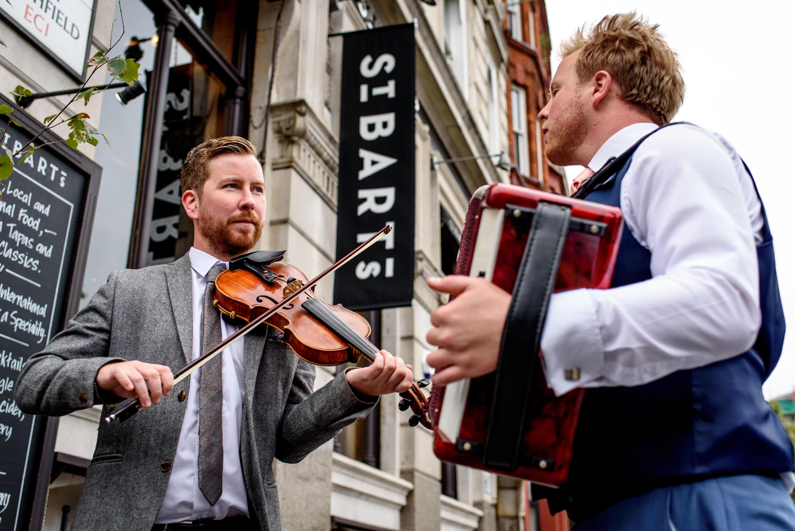 Wedding musicians playing outside St. Barts Brewery in London