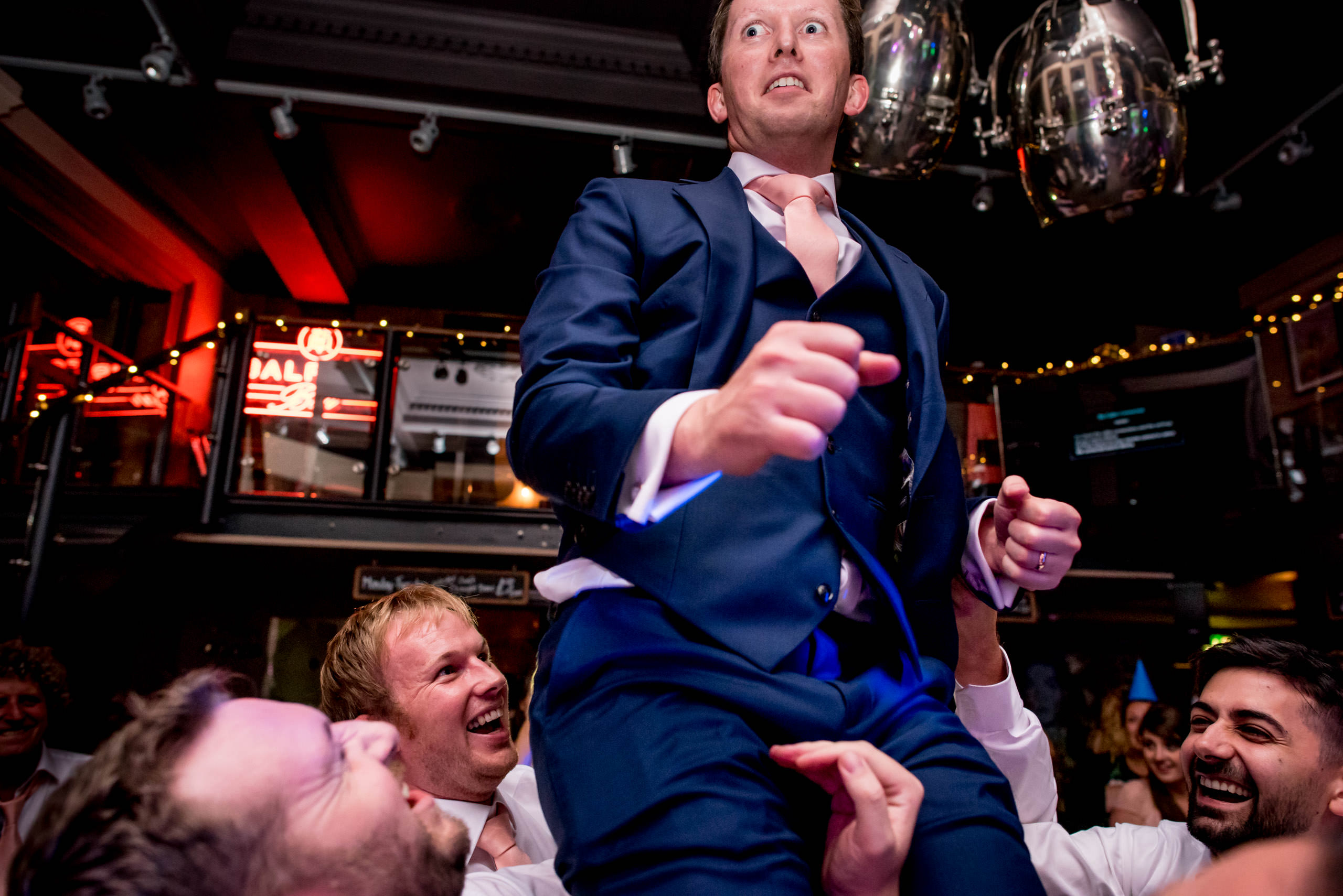 Groom being thrown in the air at a St Bart's Brewery wedding in Smithfields, London