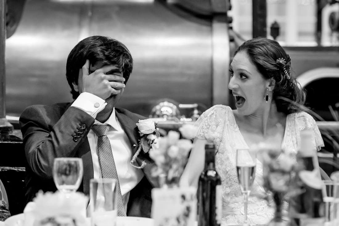 bride and groom's reactions at their water and steam museum wedding in London.