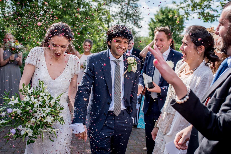 Bride and groom confetti run outside the Barn Church in Richmond