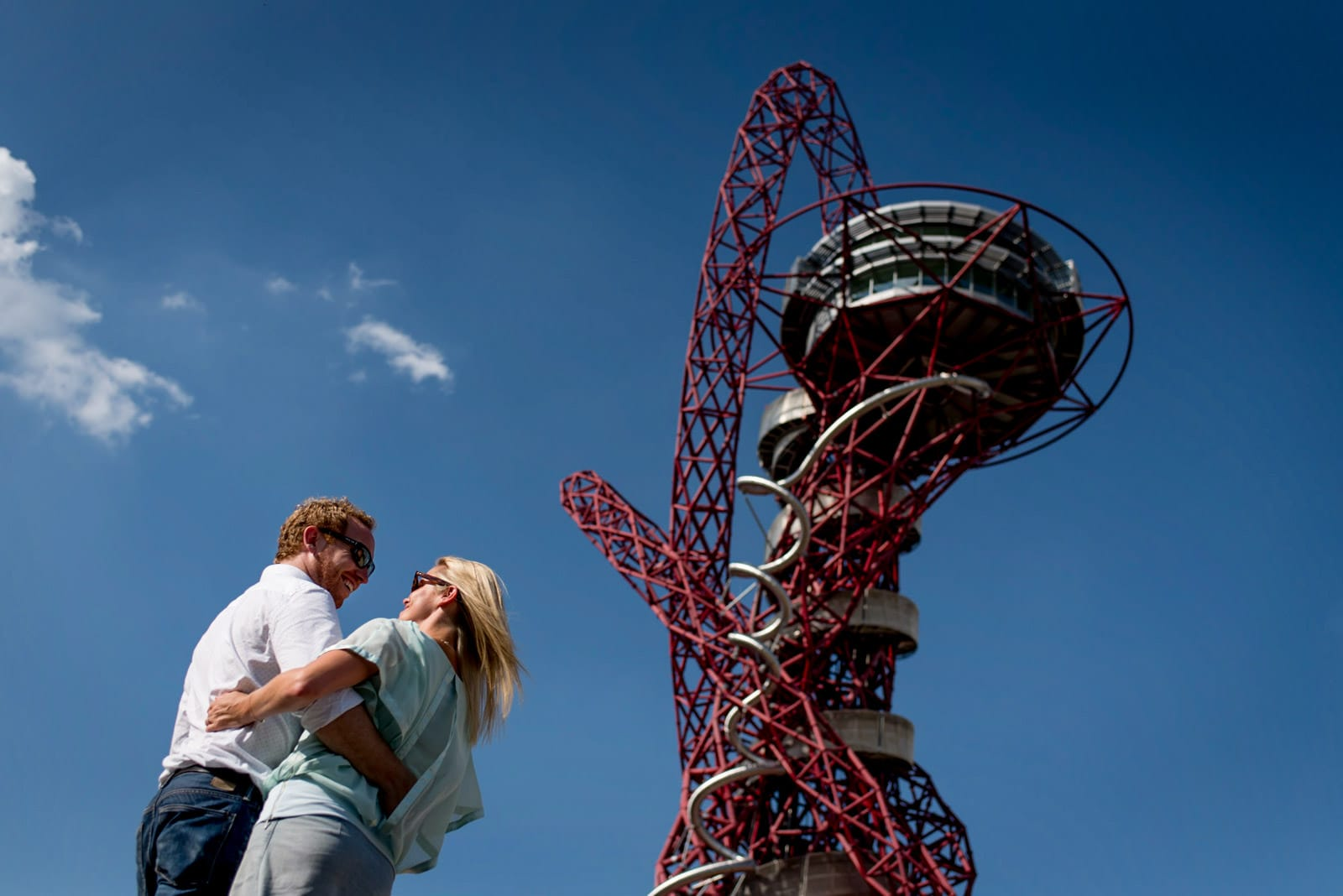 Photo of couple in front of the Orbit during their Olympic Park engagement shoot in London