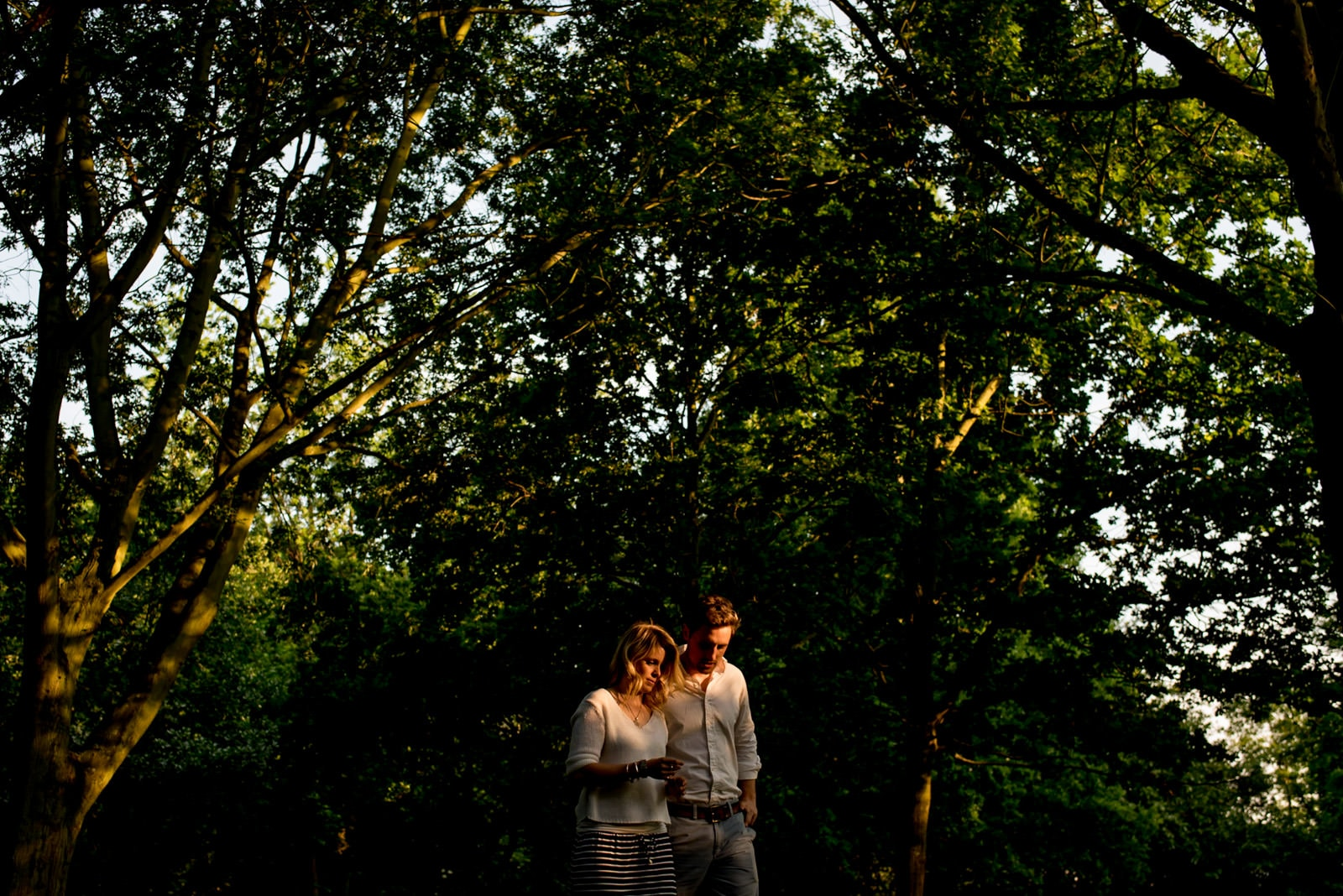 Photo of couple walking among the trees during their Regents Park engagement session