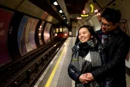 Photo of chinese couple during their London engagement shoot on the Underground