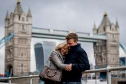 Photo of couple hugging during their Tower Bridge Engagement shoot in London