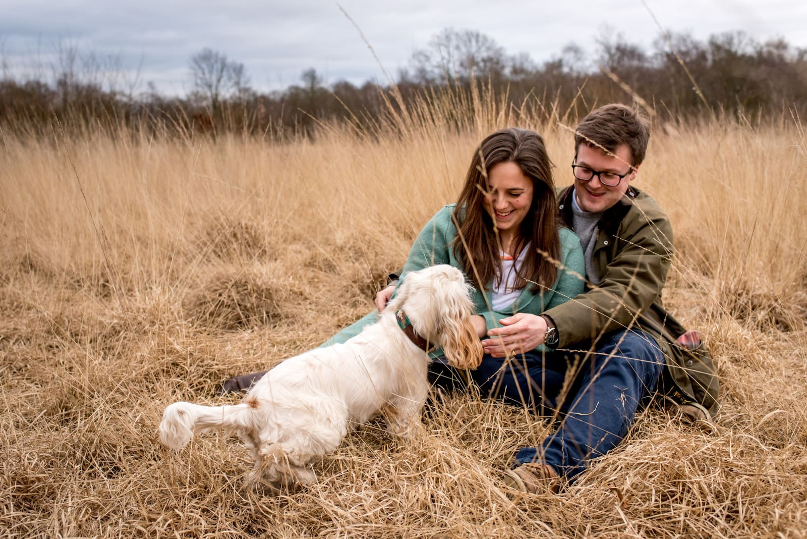 Photo of couple with dog during their London engagement photos