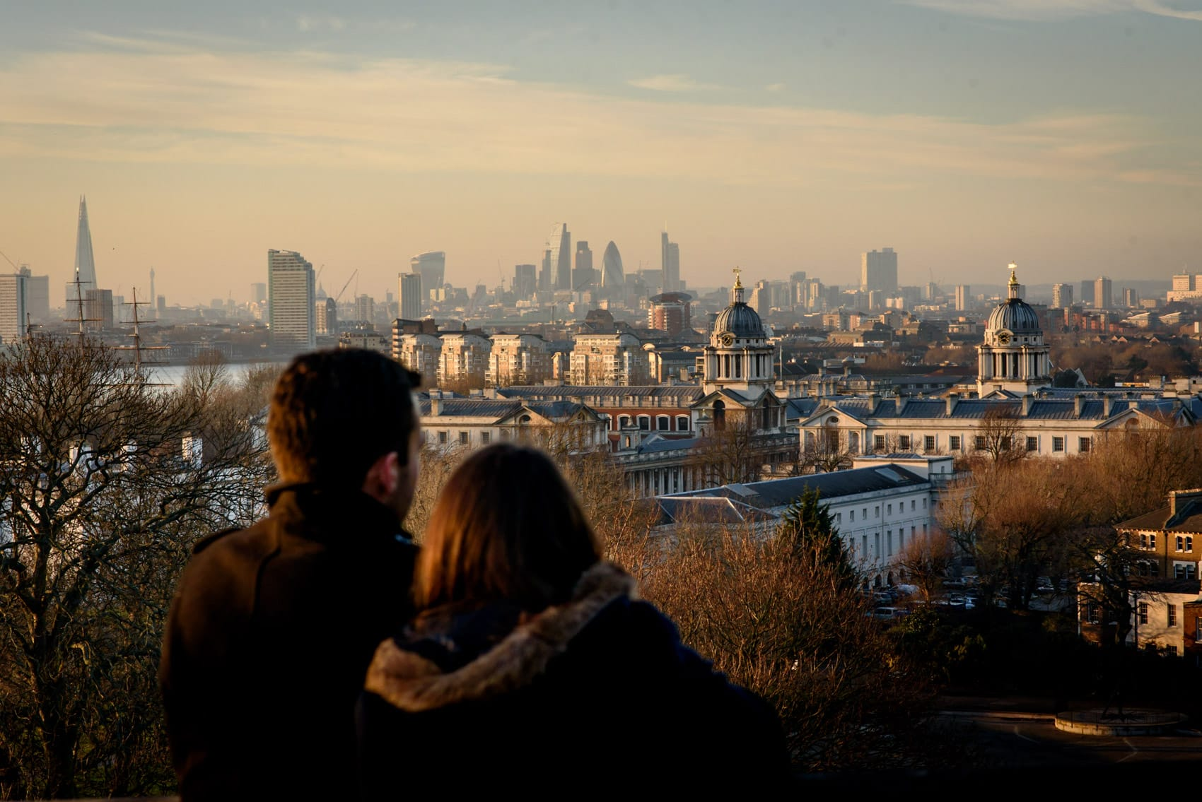 Photo of couple over looking London at sunset during their Greenwich Park engagement photo shoot