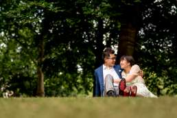 Photo of Asian couple during their Regent's Park engagement photo shoot in London wearing summer clothes