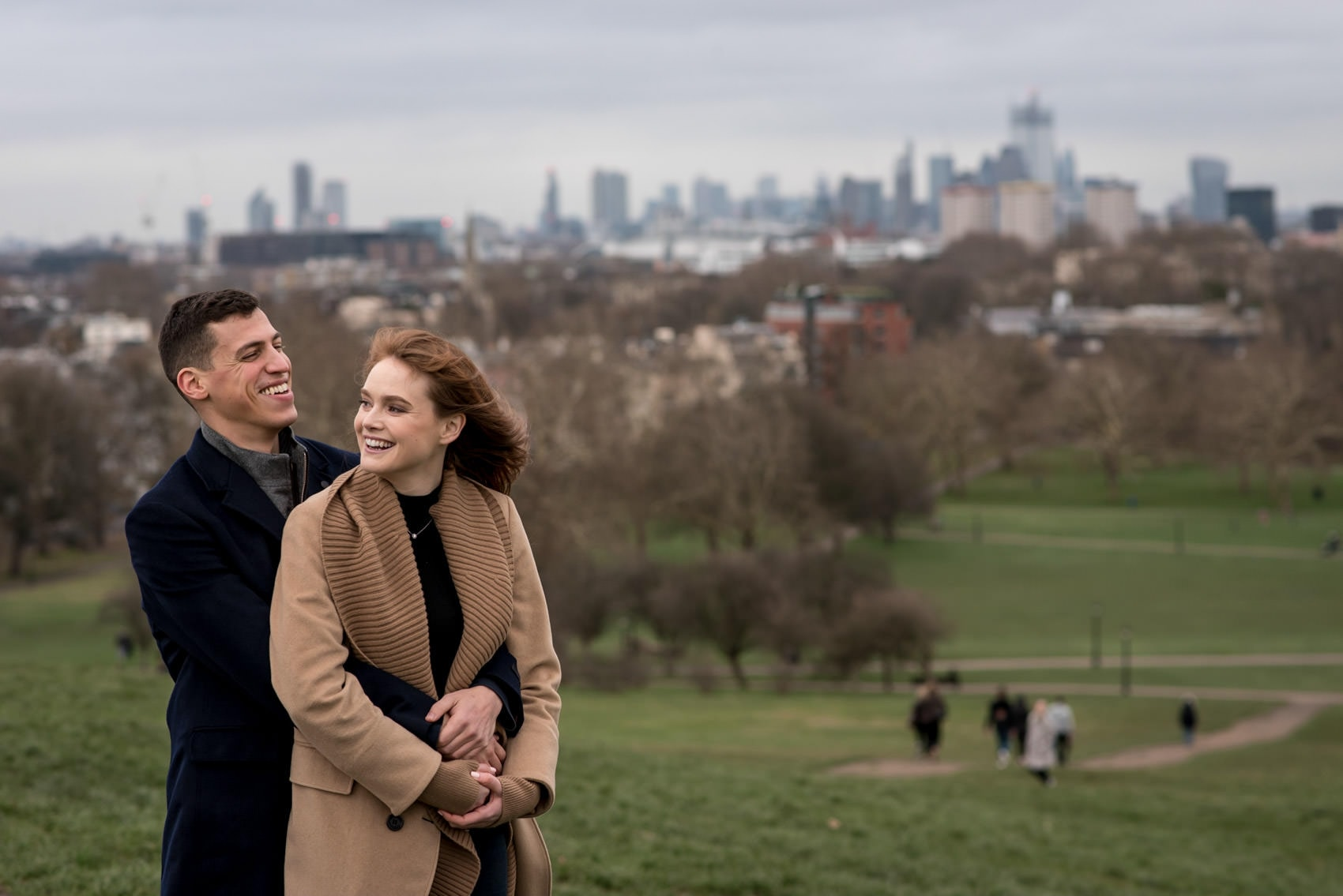 Photo of couple who just got engaged in primrose hill, one of the best London locations for a proposal