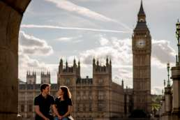 Photo of couple wearing tshirts in front of Big Ben during their London engagement shoot