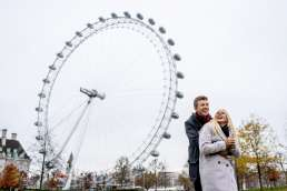 Photo of couple laughing during their London Eye engagement photography shoot in London