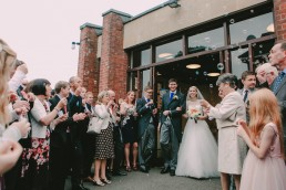 Bubble confetti being blown at wedding couple