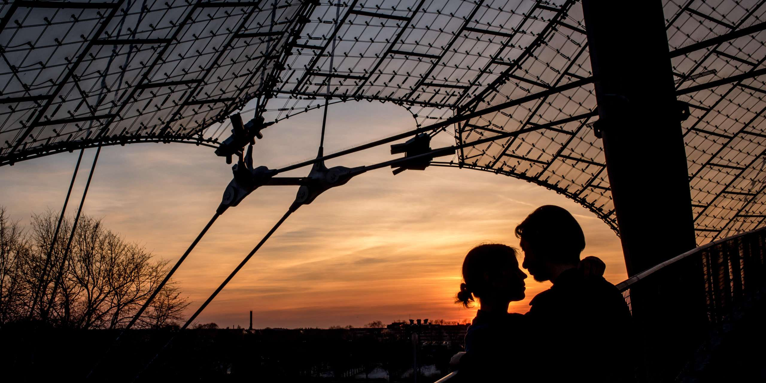 sunset at the Munich Olympic Stadium with a couple on their engagement shoot