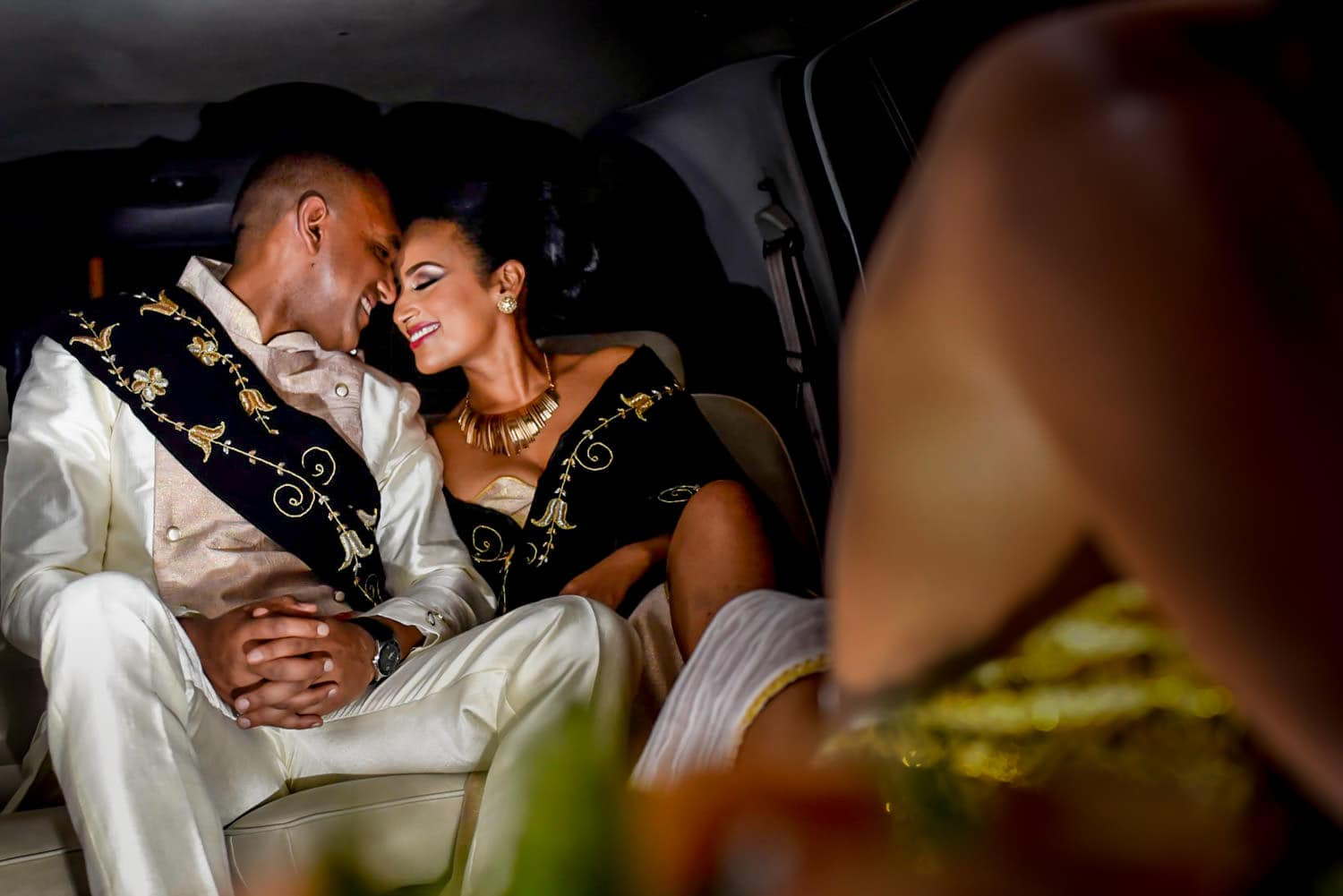 Ethiopian Bride and groom enjoying a quite moment at the back of the limo