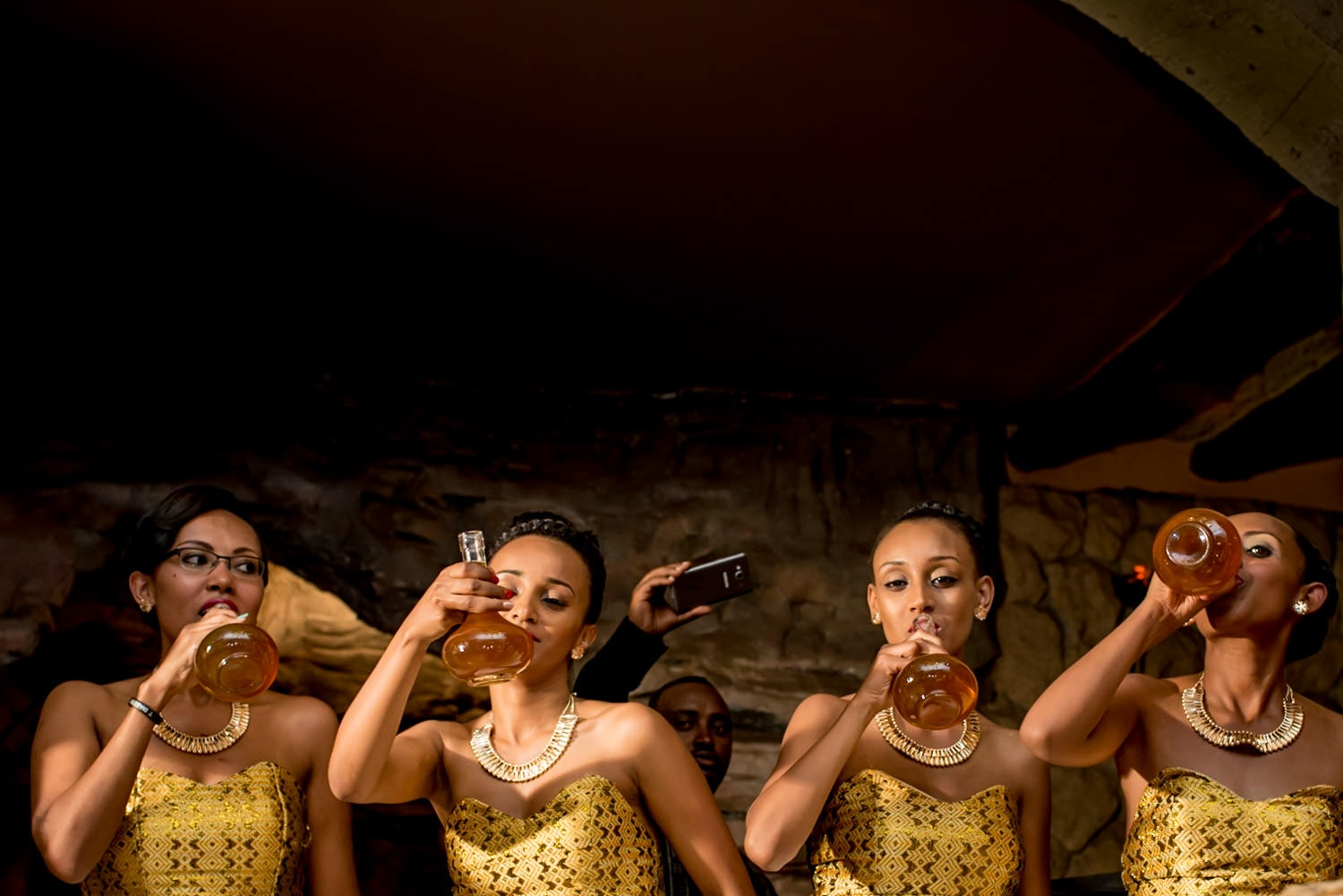 Ethiopian bridesmaids drinking honey wine at the wedding