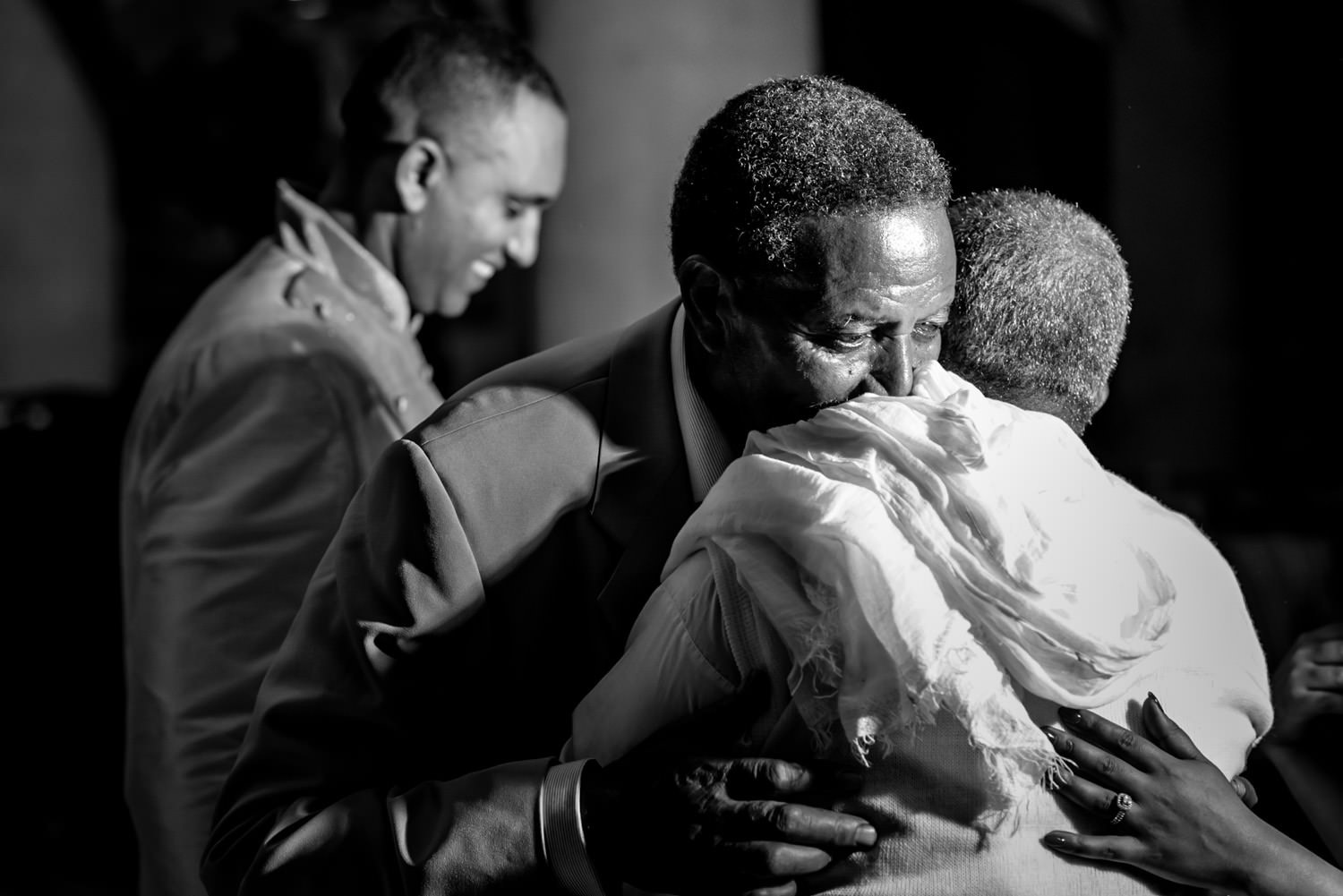 Ethiopian wedding photography of the father of the groom hugging father of the bride