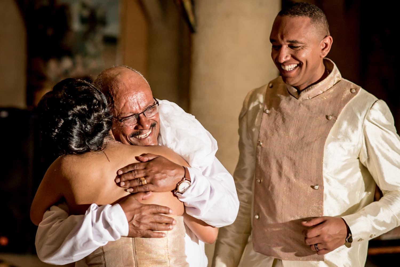 father hugging bride at Ethiopian Wedding