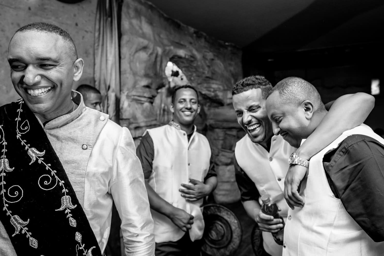 Ethiopian groom laughing with his groomsmen at his wedding