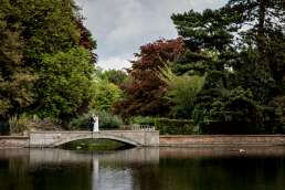 Bride and groom portrait on the bridge over Carshalton ponds