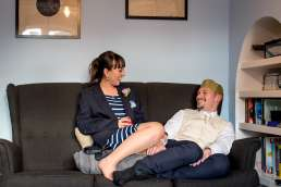 bride and groom chilling on the sofa in their house at their intimate garden wedding