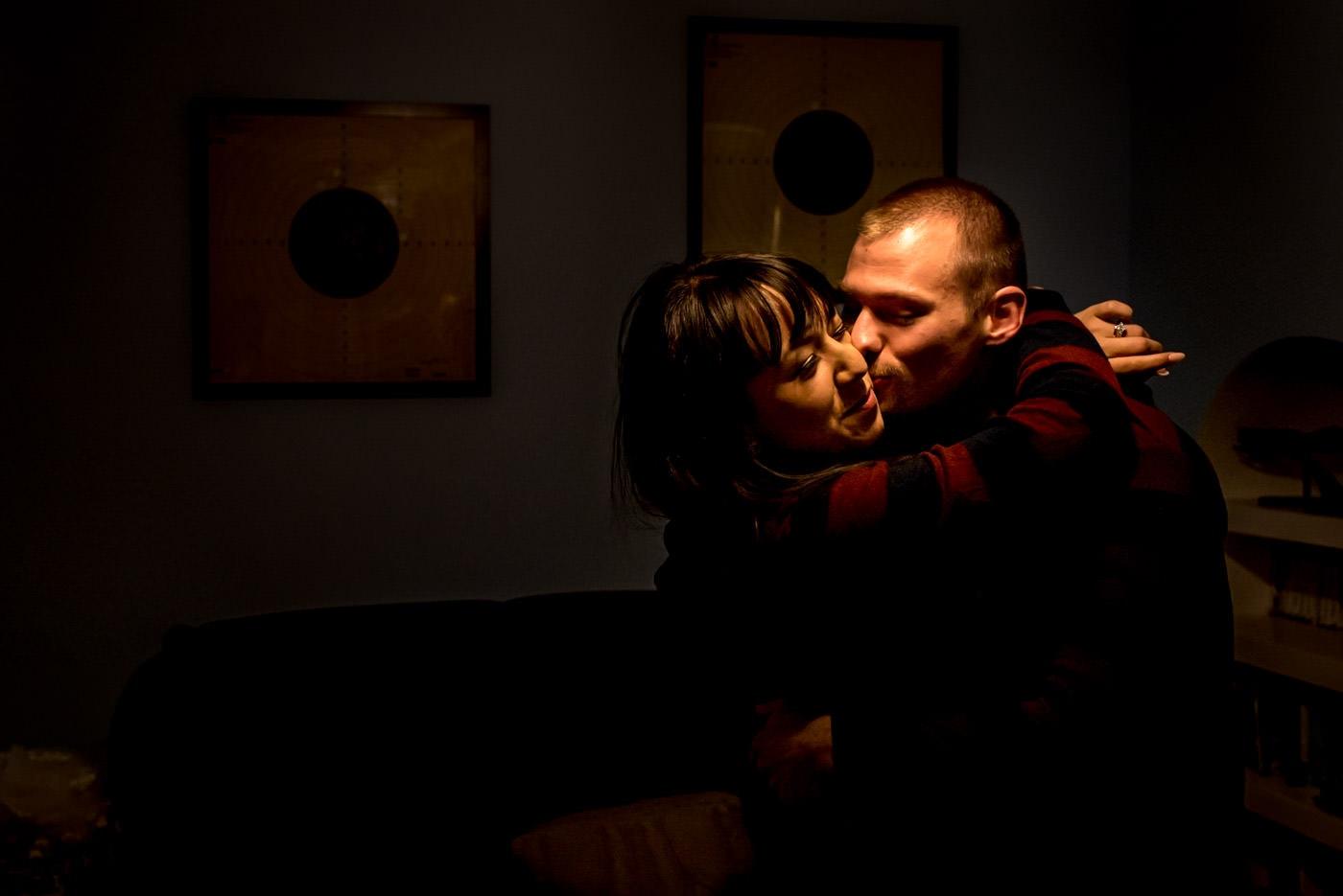 bride and groom kissing in their matching onsies