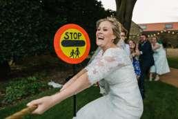 bride playing tug of war at her wedding